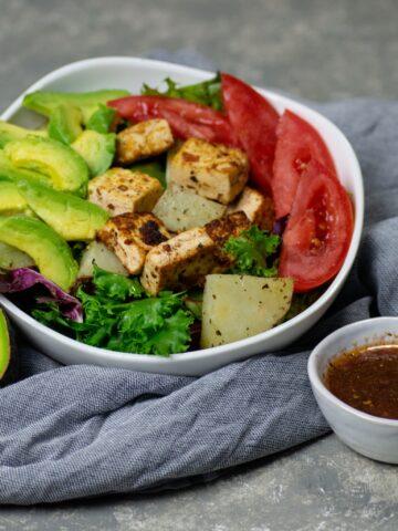 tofu and potato breakfast salad with avocado and dressing