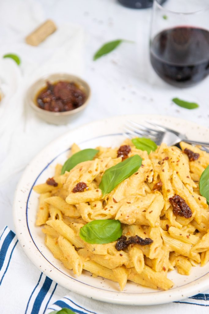 Plate of cauliflower, roasted garlic & sun-dried tomato pasta.