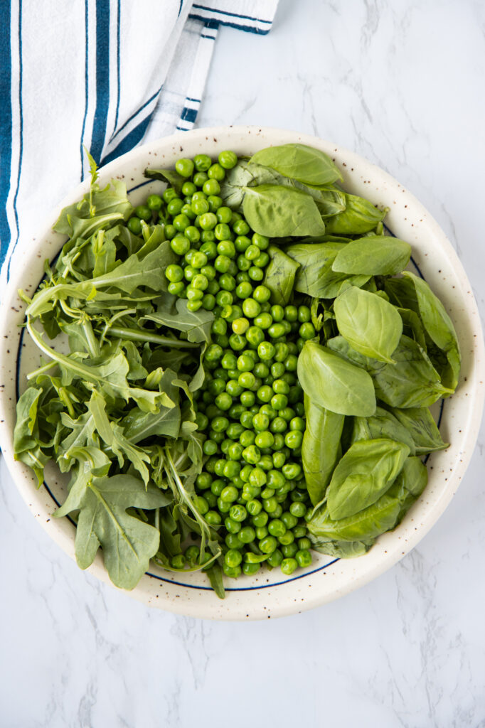 Plate with arugula, green peas and basil
