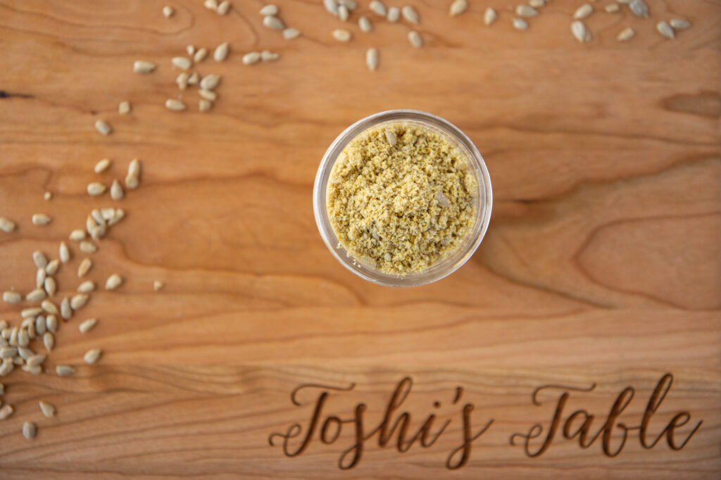 sunflower seed parmesan in a jar