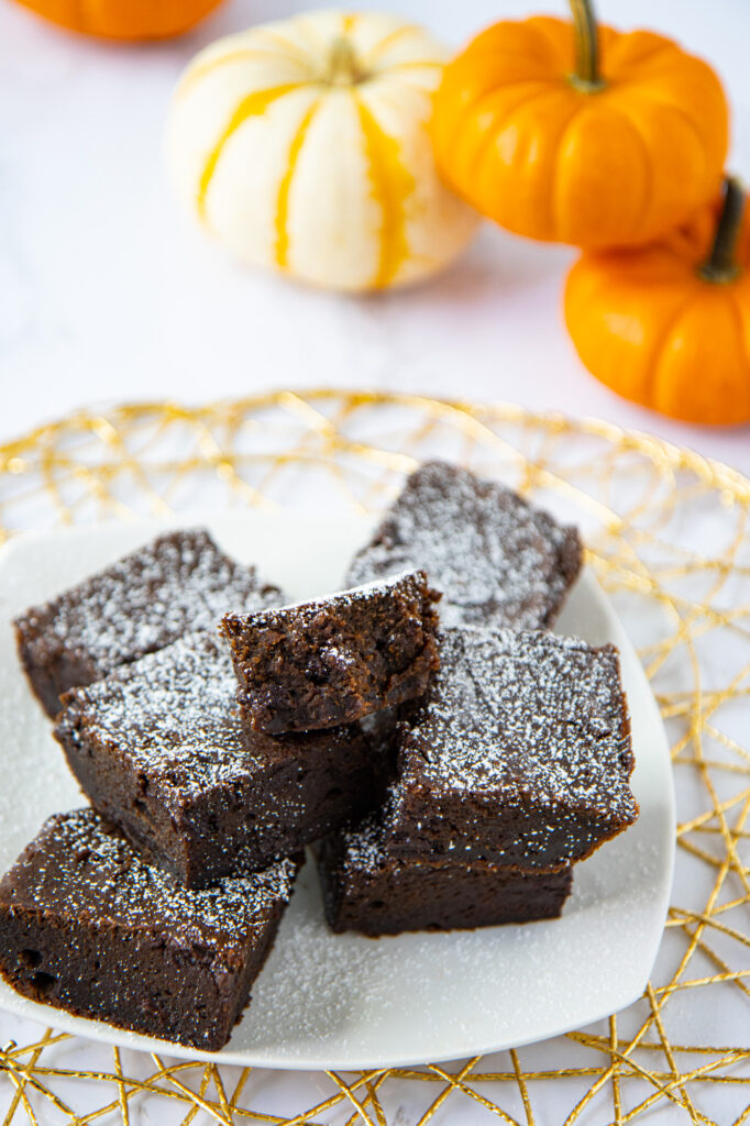 Plate of pumpkin spice brownies with decorative pumpkins