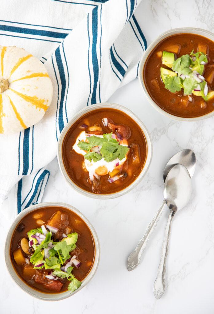 Three bowls of butternut squash chili