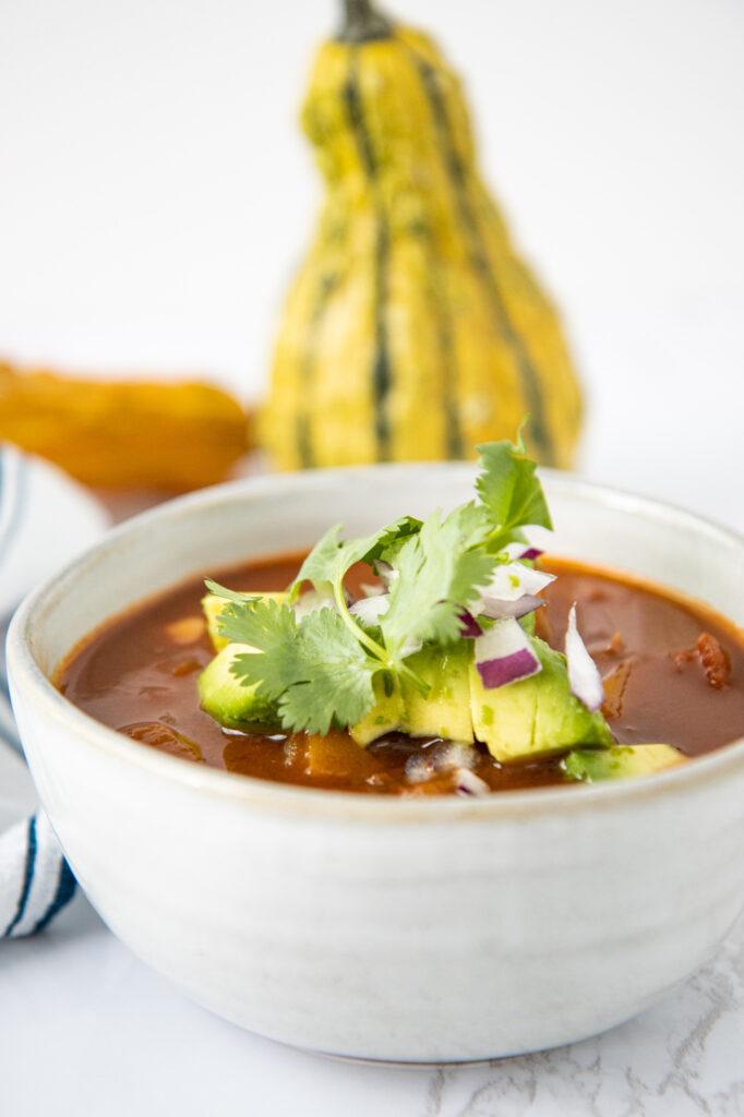 Bowl of butternut squash chili with cilantro