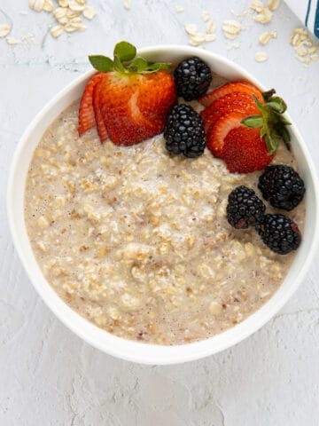 PB&J overnight oats in a bowl with berries