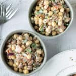 tahini bean salad in two small bowls