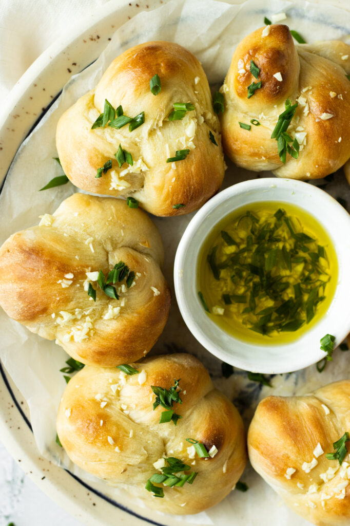 garlic knots with chives on a plate