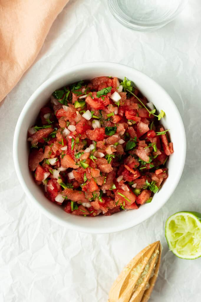 watermelon salsa in a bowl with lime