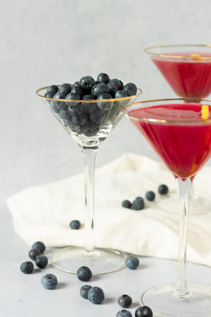 Blueberry lemon drop martinis in martini glasses