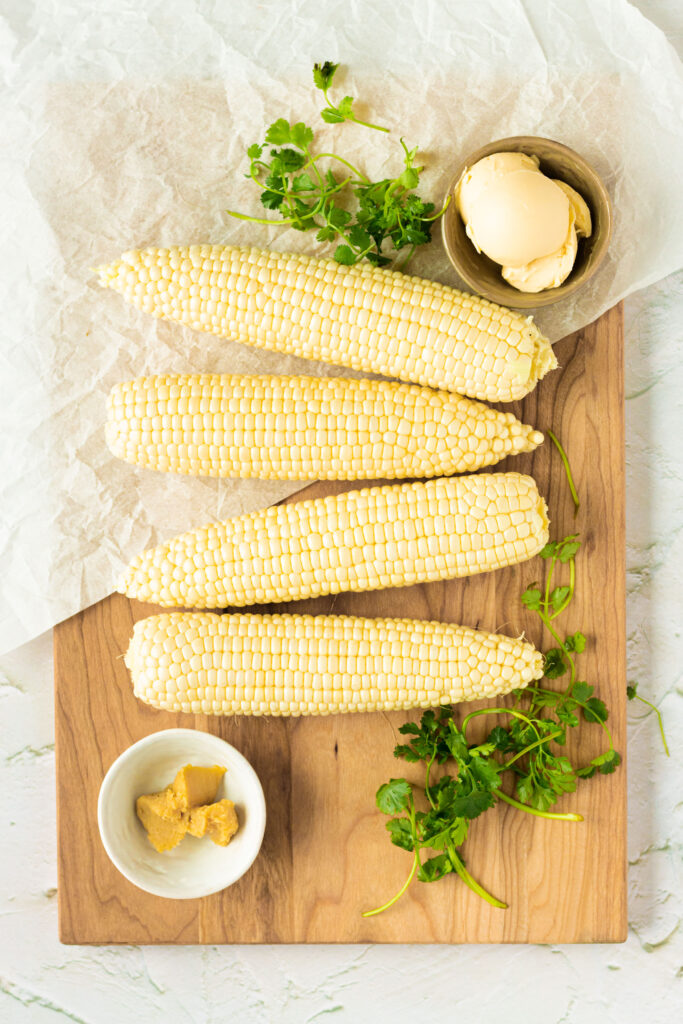 Ingredients for grilled corn with vegan miso butter
