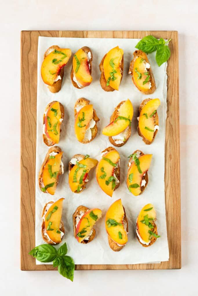 summer peach crostini on cutting board