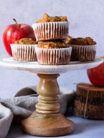 stack of apple oat muffins on a cake stand