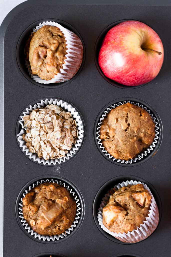 apple oat muffins in a muffin tray